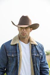 portrait of a hot cowboy in a denim jacket