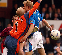Hearts v Rangers, Scottish Premier League, Tynecastle Stadium, Edinburgh.<br />, Sunday September 21st. 2003.<br />Egil Østenstad and keeper Tepi Moilanen collides in the the ghoalmouth. Keeper went off with badly cut face<br />Photo; Iian Stewart, Digitalsport