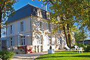 Chateau Belingard and garden in autumn evening sunshine Chateau Belingard Bergerac Dordogne France