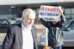 © Licensed to London News Pictures . 24/09/2017. Brighton, UK. JEREMY CORBYN arrives for the Marr Show , photobombed by serial protester Stuart Holmes and his dog . The first day of the Labour Party Conference in and around The Brighton Centre . Photo credit: Joel Goodman/LNP