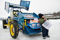 Xander Gilchreast stands in front of Fabian Smith's modified 4 cyl. RWD that will race on Meredith Bay during the Latchkey Cup Saturday, February 17th with the Lakes Region Ice Racing Club.   (Karen Bobotas/for the Laconia Daily Sun)