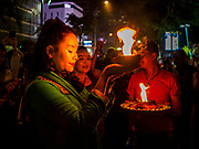 19 OCTOBER 2018 - BANGKOK, THAILAND: A woman prays with a pot of fire during Navratri observances in Bangkok. Navratri is a nine night (10 day) long Hindu celebration that marks the end of the monsoon and honors of the divine feminine Devi (Durga). The festival is celebrated differently in different parts of India, but the common theme is the battle and victory of Good over Evil based on a regionally famous epic or legend such as the Ramayana or the Devi Mahatmya. Navratri is celebrated throughout Southeast Asia in communities that have a large Hindu population. Because Navratri honors the feminine Devi, Navratri is especially popular with Thai women and transgendered people.  PHOTO BY JACK KURTZ