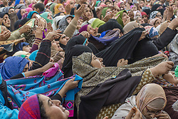November 21, 2018 - Srinagar, Jammu and Kashmir, India - Kashmiri Muslim women devotees look towards a cleric (not seen in the picture) displaying the holy relic believed to be the whisker from the beard of the Prophet Mohammed, at Hazratbal shrine on the, Eid-e-Milad , or the birth anniversary of Prophet Mohammad on November 21, 2018 in Srinagar, the summer capital of Indian administered Kashmir, India. Thousands of Muslims from all over Kashmir visited the Hazratbal shrine in Srinagar to pay obeisance on the Eid-e-Milad , or the birth anniversary of Prophet Mohammed. The shrine is highly revered by Kashmiri Muslims as it is believed to house a holy relic of the Prophet Mohammed. The relic is displayed to the devotees on important Islamic days such as the Eid- Milad when Muslims worldwide celebrate. (Photo by Kabli Yawar /Nur Photos) (Credit Image: © Kabli Yawar/NurPhoto via ZUMA Press)