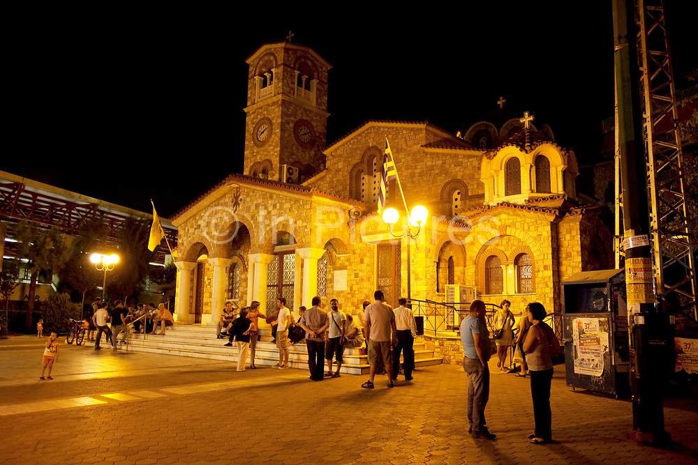Eastern Orthodox parish church of Saint Barbara in Ano Patissia. Night scene with people gathering outside their place of worship. Saint Barbara, known in the Eastern Orthodox Church as the Great Martyr Barbara, was an early Christian saint and martyr. Athens is the capital and largest city of Greece. It dominates the Attica periphery and is one of the world's oldest cities, as its recorded history spans around 3,400 years. Classical Athens was a powerful city-state. A centre for the arts, learning and philosophy.