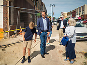 10 JULY 2019 - MARSHALLTOWN, IOWA: Governor STEVE BULLOCK (D-MT), center, walks through downtown Marshalltown after a campaign stop there Wednesday. Gov. Bullock is in a crowded field of Democrats vying to be the party's Presidential nominee in 2020. Iowa traditionally hosts the the first election event of the presidential election cycle. The Iowa Caucuses will be on Feb. 3, 2020.     PHOTO BY JACK KURTZ