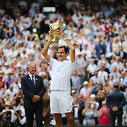 LONDON, ENGLAND - JULY 16: Roger Federer of Switzerland celebrates victory with the trophy after the Gentlemen's Singles final of the Wimbledon Lawn Tennis Championships at the All England Lawn Tennis and Croquet Club at Wimbledon on July 16, 2017 in London, England. (Photo by Tim Clayton/Corbis via Getty Images)