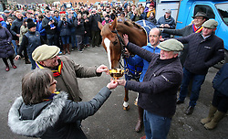 Colin Tizzard with Native River and owners Garth and Anne Broom during a Gold Cup winners photocall at Virginia Ash, Templecombe.