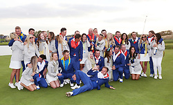Team Europe celebrate with their wives, girlfriends and the Ryder Cup trophy on day three of the Ryder Cup at Le Golf National, Saint-Quentin-en-Yvelines, Paris.