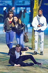 © Licensed to London News Pictures . 07/04/2017 . Manchester , UK . 13th in a sequence . Five youths on one as a fight breaks out in which a man's head is kicked and stamped upon , in Piccadilly Gardens . Greater Manchester Police have authorised dispersal powers and say they will ban people from the city centre for 48 hours , this evening (7th April 2017) , in order to tackle alcohol and spice abuse . Photo credit : Joel Goodman/LNP