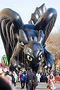 """NEW YORK, NY, USA, Nov. 28, 2013. A balloon depicting """"Toothless,"""" a character in the animated movie """"How to Train Your Dragon"""" moves down Central Park West during the 87th Annual Macy's Thanksgiving Day Parade. The Toothless balloon is new to the parade this year."""