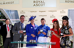 Owner Princess Haya of Jordan (right) and daughter Sheikha Al Jalila bint Mohammad bin Rashid al Maktoum, Jockey William Buick and trainer Charlie Appleby are presented with the trophies by Clare Balding after winning the King Edward VII Stakes with Old Persian during day four of Royal Ascot at Ascot Racecourse.