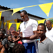 Dwight Howard enters a camp in Haiti during his recent trip to the island to promote the Dwight Howard Fund.  Mandatory Credit: Alex Menendez Dwight Howard in Haiti after the 2010 earthquake for the D12 Foundation relief fund.