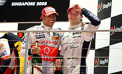 Lewis Hamilton (left) and Nico Rosberg on the podium after their second and third place finishes at the Singapore Grand Prix