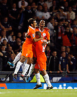 Football<br /> 09/09/2009 SCOTLAND V NETHERLANDS: EIJERO ELIA CELEBRATES SCORING THE ONLY GOAL OF THE GAME FOR HOLLAND WITH GIOVANNI VAN BRONCKHORST AND NIGEL DE JONG  DURING THE 2010 WORLD CUP QUALIFIER AT HAMPDEN PARK, GLASGOW.<br /> CREDIT: COLORSPORT