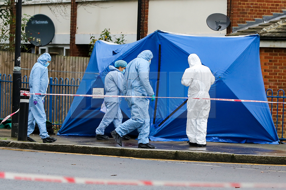 © Licensed to London News Pictures. 20/01/2021. London, UK. Forensic officers next to a police tent on West Green Road in Haringey, north London as police launch a murder investigation following the fatal stabbing of a teenage boy in Haringey. Police were called at 21:10hrs on Tuesday 19 January 2021 to the West Green Road junction with Willow Walk, following reports of a stabbing. Officers attended with the London Ambulance Service and found a male, aged 17, suffering from a stab injury. The victim was pronounced dead at 04:25hrs on Wednesday 20 January. . Photo credit: Dinendra Haria/LNP