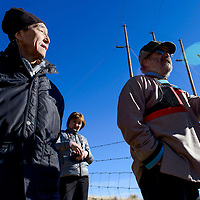 112214       Cable Hoover<br /> <br /> Sergei Shapkhaev, left, listens as Paul Robinson of the Southwest Research and Information Center talks about the 1979 uranium spill during a tour in Churchrock Saturday.