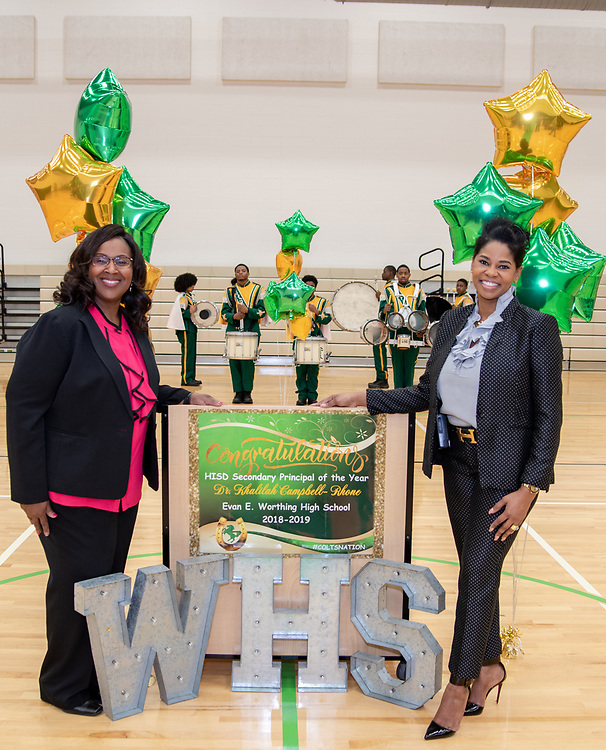 Interim Superintendent Grenita Lathan congratulates principals of Durham Elementary School and Worthing High School for with Principal of the Year award.