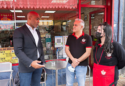 """© Licensed to London News Pictures; 24/05/2021; Bristol, UK. Bristol's elected Mayor MARVIN REES, chats with staff from The Sunshine Cafe on East Street in Bedminster. The mayor met shoppers and traders in Bedminster to launch """"Where's it To?"""", a new high street support campaign by Bristol City Council. Where's it to? is an invitation to Bristolians to explore their local high streets, shop local and get to know the traders behind the businesses. 15 high streets across the city will be profiled, highlighting numerous traders on each street, which span from stores passed through generations of a family, through to brand new openings inspired by the covid coronavirus pandemic. The phrase """"Where's it to?"""" is what Bristolians traditionally say meaning 'where is that?' and  was selected as the name of the campaign to reflect the city's language and in collaboration with a huge range of traders from across the 15 high streets. Photo credit: Simon Chapman/LNP."""