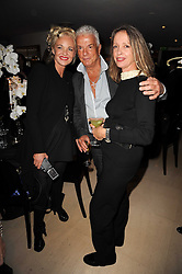 Left to right, AMANDA ELIASCH, NICKY HASLAM and SABRINA GUINNESS at the launch party for 'Promise', a new capsule ring collection created by Cheryl Cole and de Grisogono held at Nobu, Park Lane, London on 29th September 2010.