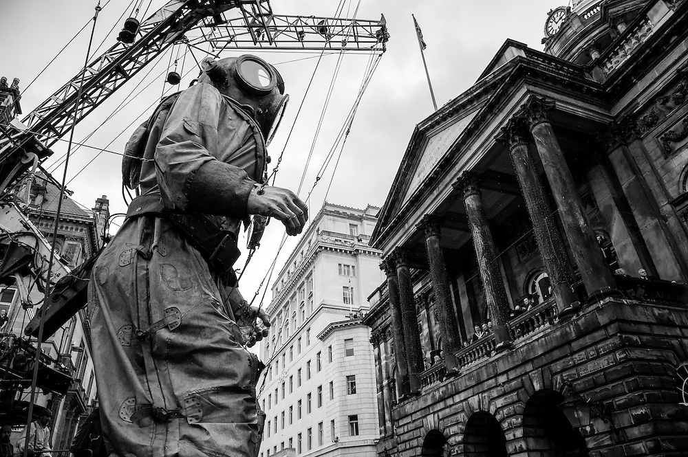 LIVERPOOL, UK, 20th April, 2012. The Sea Odyssey. The giant Uncle greets the Lord Mayor at the town hall.