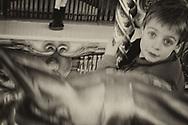 Boy riding on a merry go round