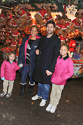 ANGELA GRIFFIN and her husband JASON MILLIGAN and their children MISSY & TALLULAH at the opening of the 2012 Winter Wonderland, Hyde Park on 22nd November 2012.