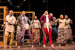 © Licensed to London News Pictures. 17/05/2012. London, UK.  Featuring a magnificent score played by an orchestra of marimbas and steel pans together with the world-class voices and extraordinary acting talent of the Ensemble. Picture shows: Simphiwe Mayeki, Katlego, Luvo Rasemani and members of the company in La Bohéme. Photo credit : Tony Nandi/LNP