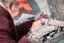 11 June 2017, Saint Petersburg, Russia. A local artist paints an oil panorama of the on of the city's water channels.