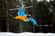 Olie Daunfeldt of Sweden goes head first over a jump during the qualifying round in the men's World Cup freestyle skiing moguls competition at Deer Valley Resort, Thursday, Jan. 14, 2010, in Park City, Utah. (AP Photo/Colin E Braley