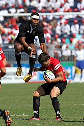 Lote Raikabula battles for the high ball during the XIX Commonwealth Games 7s rugby match between New Zealand and Canada held at The Delhi University in New Delhi, India on the  10 October 2010..Photo by:  Ron Gaunt/photosport.co.nz