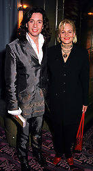 MR & MRS LAURENCE LLEWELYN-BOWEN, he is the interior designer, at a reception in London on 2nd February 2000.OAP 3