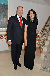 H.S.H.PRINCE ALBERT II OF MONACO and RENU MEHTA at the Fortune Forum Club dinner in the presence of HSH Prince Albert II of Monaco held at The Dorchester, Park Lane, London on 15th January 2014.