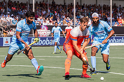 (L-R) Surender Kumar of India, Jeroen Hertzberger of The Netherlands, Jarmanpreet Singh of India during the Champions Trophy match between the Netherlands and India on the fields of BH&BC Breda on June 30, 2018 in Breda, the Netherlands