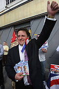 Leader of the British National Party Nick Griffin waves to passing supporters when he is out on the campaign trail n the constituency of Barking and Dagenham.