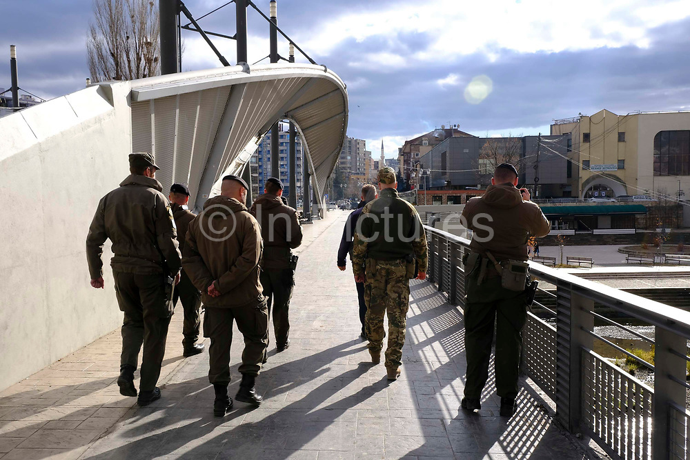 UN troops crossing the Mitrovica bridge on peacekeeping patrol, over the river Ibar which separates the Serbian and Albanian districts of Mitrovica, Kosovo on the 12th of December 2018, it was rebuilt with funding from the EU. Mitrovica or Kosovska Mitrovica is a city and municipality located in Kosovo. Settled on the banks of Ibar and Sitnica rivers, the city is the administrative center of the Mitrovica District.