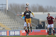 Cambridge United Midfielder Luke Berry leaps for the ball  during the Sky Bet League 2 match between Northampton Town and Cambridge United at Sixfields Stadium, Northampton, England on 12 March 2016. Photo by Dennis Goodwin.