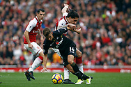 Tom Carroll of Swansea City (R) turns away from Hector Bellerín of Arsenal (L). Premier league match, Arsenal v Swansea city at the Emirates Stadium in London on Saturday 28th October 2017.<br /> pic by Steffan Bowen, Andrew Orchard sports photography.