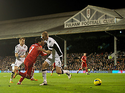 05.12.2011, Craven Cottage Stadion, London, ENG, PL, FC Fulham vs FC Liverpool, 14. Spieltag, im Bild Liverpool's Luis Alberto Suarez Diaz is fouled by Fulham's Brede Hangeland, but no penalty is given, during the football match of English premier league, 14th round, between FC Fulham and FC Liverpool at Craven Cottage Stadium, London, United Kingdom on 05/12/2011. EXPA Pictures © 2011, PhotoCredit: EXPA/ Sportida/ David Rawcliff..***** ATTENTION - OUT OF ENG, GBR, UK *****