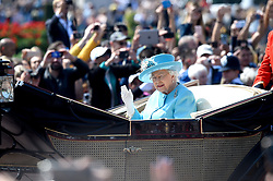 File photo dated 9/6/2018 of Queen Elizabeth II, waves to the crowds as she in rides in a carriage as it makes its way up The Mall from Buckingham Palace, central London to Horse Guards Parade, ahead of the Trooping the Colour ceremony. The military parade has marked the official birthday of the sovereign for more than 270 years.