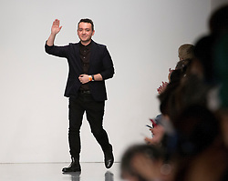 Designer Bora Aksu greets public after presenting his Autumn/Winter 2017 London Fashion Week show at BFC Show Space, London. PRESS ASSOCIATION. Picture date: Friday February 17, 2017. Photo credit should read: Isabel Infantes/PA Wire