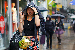© Licensed to London News Pictures. 23/06/2016. London, UK. People take shelter from the rain in Islington, London on the polling day of the EU referendum on 23 June 2016. Photo credit: Tolga Akmen/LNP