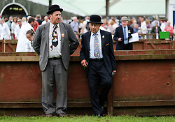 © Licensed to London News Pictures.14/07/15<br /> Harrogate, UK. <br /> <br /> Two stewards talk as they wait for the next heat to begin in the pig judging on the opening day of the Great Yorkshire Show.  <br /> <br /> England's premier agricultural show opened it's gates today for the start of three days of showcasing the best in British farming and the countryside.<br /> <br /> The event, which attracts over 130,000 visitors each year displays the cream of the country's livestock and offers numerous displays and events giving the chance for visitors to see many different countryside activities.<br /> <br /> Photo credit : Ian Forsyth/LNP