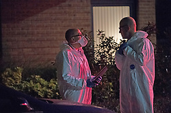 © Licensed to London News Pictures 18/09/2021. <br /> Kidbrooke, UK, Officers in forensic suits. A large police cordon is in place in Kidbrooke, South East London tonight after the body of a woman was found near a community centre. A man from Lewisham has been arrested on suspicion of murder. Photo credit:Grant Falvey/LNP