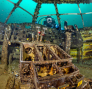 Scuba diver checks out the cockpit of the Aircraft Challenger 600 at Dutch Springs, Scuba Diving Resort in Pennsylvania