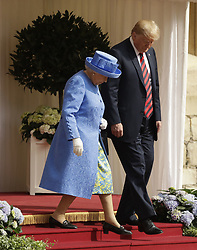 US President Donald Trump and Queen Elizabeth II prepare to inspect a Guard of Honour, formed of the Coldstream Guards, at Windsor Castle, Windsor.