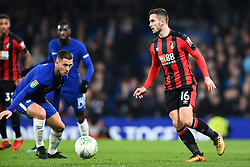 December 20, 2017 - London, England, United Kingdom - Chelsea Midfielder Eden Hazard eyes the ball with Bournemouth's Lewis Cook during the Carabao Cup Quarter - Final match between Chelsea and AFC Bournemouth at Stamford Bridge, London, England on 20 Dec 2017. (Credit Image: © Kieran Galvin/NurPhoto via ZUMA Press)