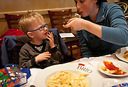 While the lunch was nearly meltdown-free, Carter Davidson gets agitated while eating a plate of macaroni and cheese during lunch at BRIO Tuscan Grill in Murray, Friday, Nov. 9, 2012.