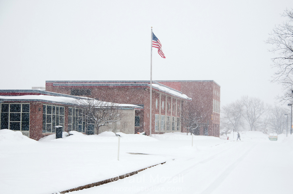 The driveway of the Dolbeare Elementary School in Wakefield, MA is empty on a snow day for the students.