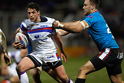 Wakefield Trinity's Scott Grix is tackled by Salford Red Devils' Lee Mossop during the Betfred Super League match at Belle Vue Stadium, Salford.