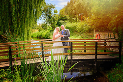 Bride and Groom on bridge at Quy Mill Hotel & Spa in Cambridge